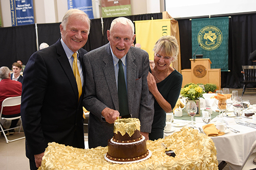 Barney Clarkson with President Tony Collins and wife Karen at a trustee dinner.